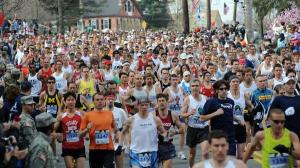 Thousands of runners pack the Boston Marathon course